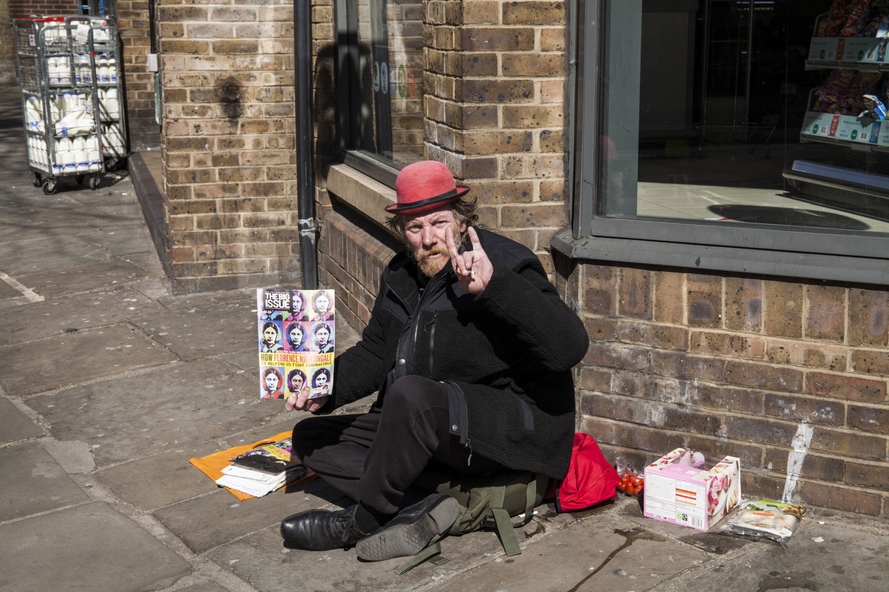 Homeless Man holding Big Issue with Florence Nightingale Warhol style Cover